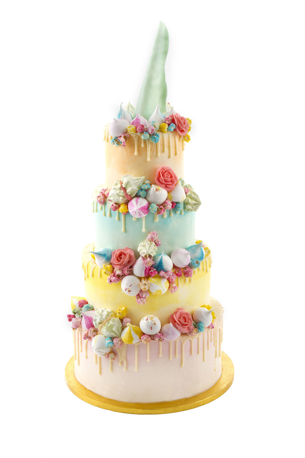 Add piped buttercream roses for a whimsical rainbow effect.