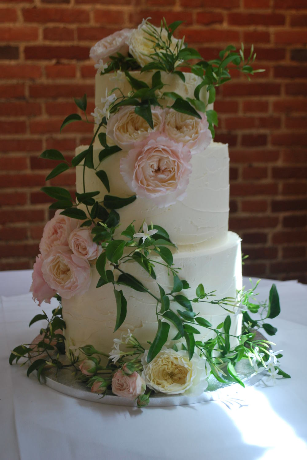 Blog emma page buttercream cakes bespoke wedding and celebration heres a real stunner a rich chocolate madeira and lemon cake frosted with crusting vanilla buttercream and dressed with beautiful david austin roses and izmirmasajfo