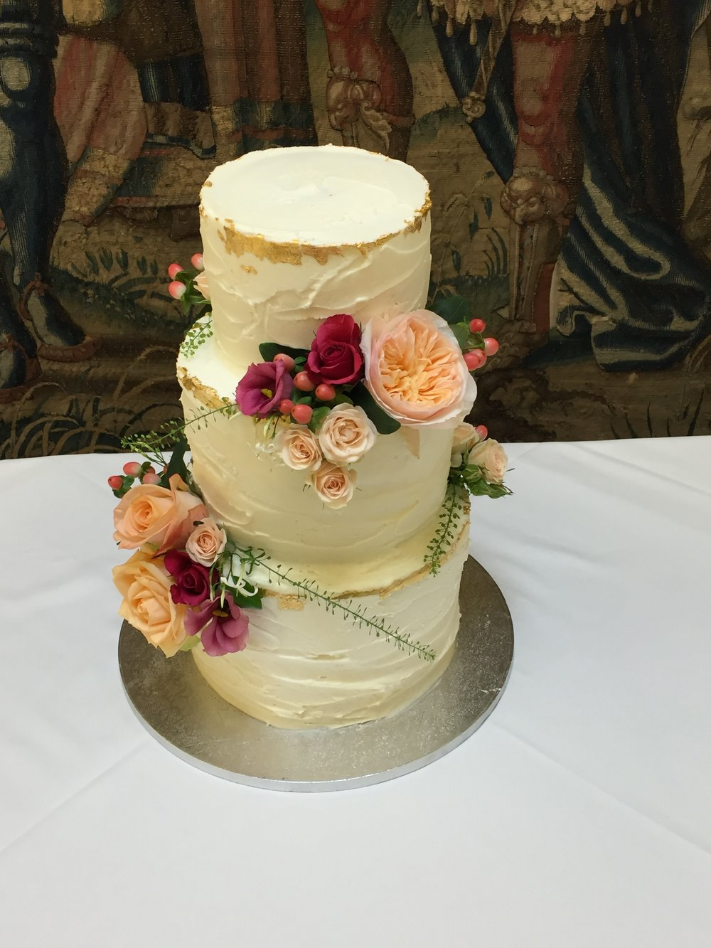 Rustic buttercream cake with fresh flowers from £410 Emma Page Buttercream Cakes
