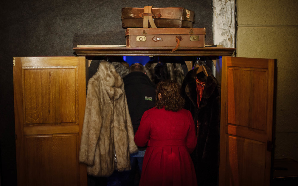 Guests arrived at our secret location, marked only by the familiar site of a wardrobe, bursting with fur coats.