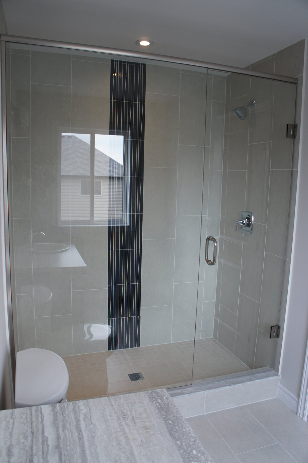 "Frameless Glass Shower   Adding a glass shower to your bathroom creates a modern and elegant ""spa like"" look. Your bathroom will sparkle and appear larger because the glass will allow light to flow through the room."