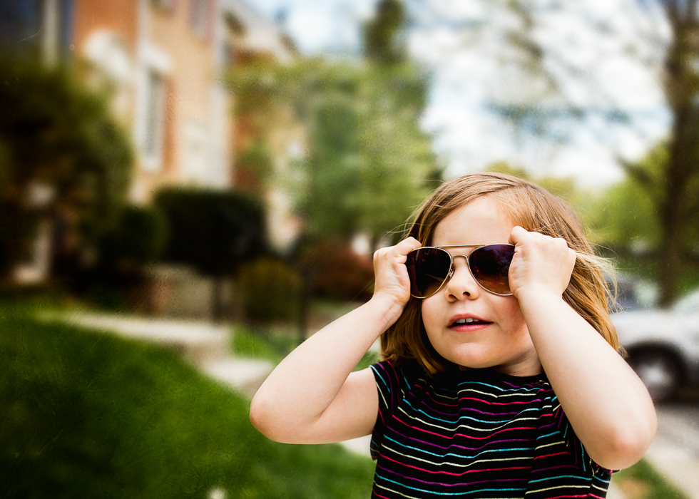 Cool preschool aged girl in aviator sunglasses
