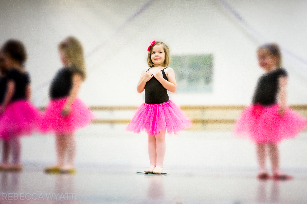 Four Year old dancer at recital in pink tutu.
