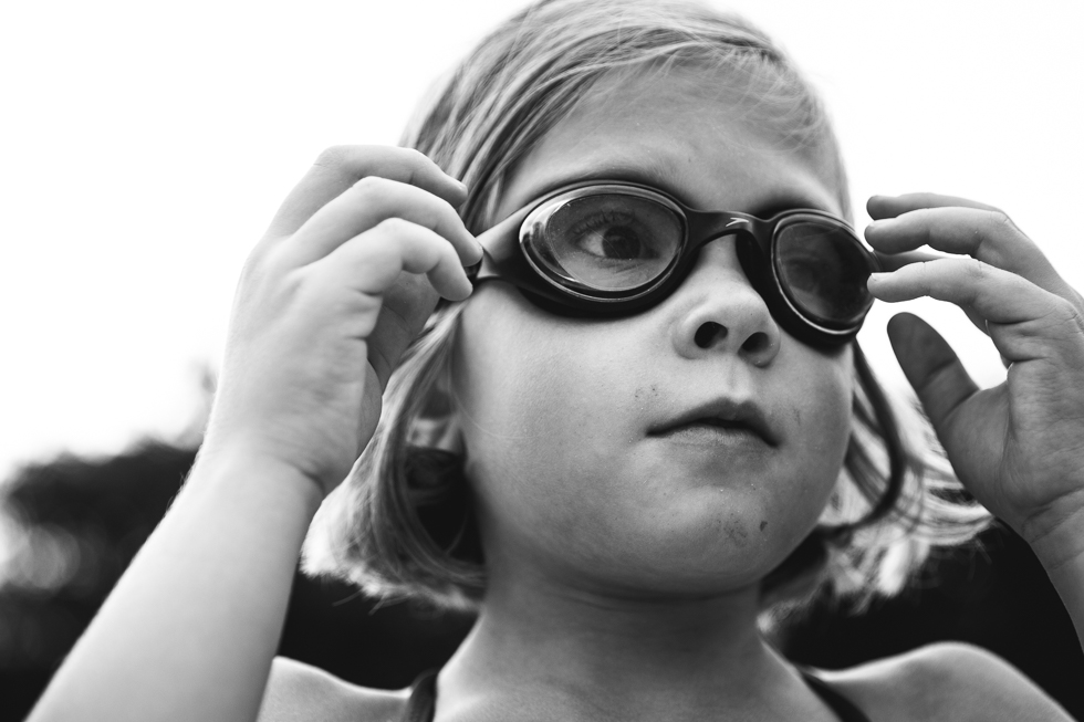 black and white photo of girl wearing goggles