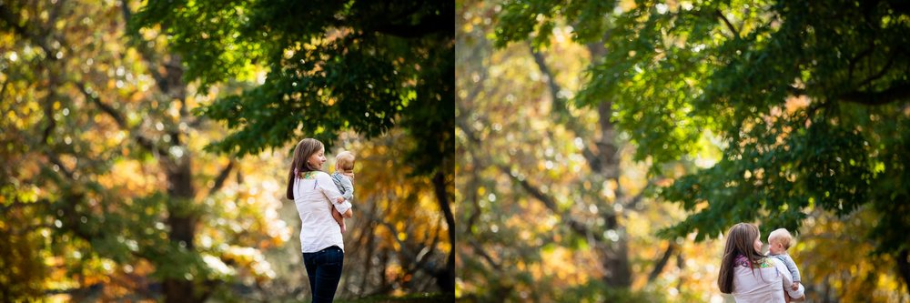 Young mom and baby playing in a local park amidst fall foliage.