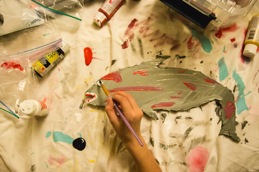 child painting an art project of a shark