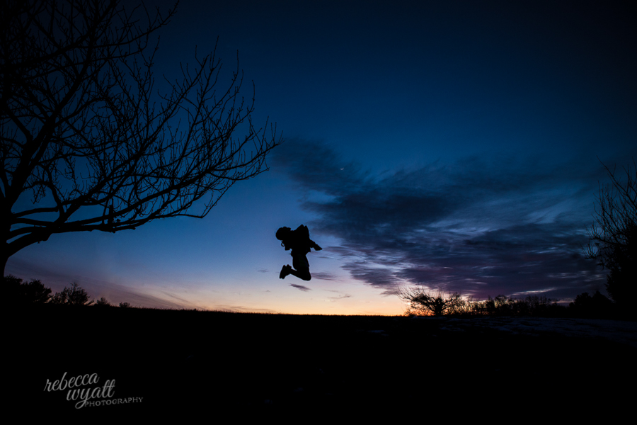girl jumping silhouette at sunset