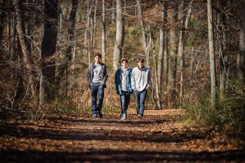 Copy of Teenage boys walking through the woods.