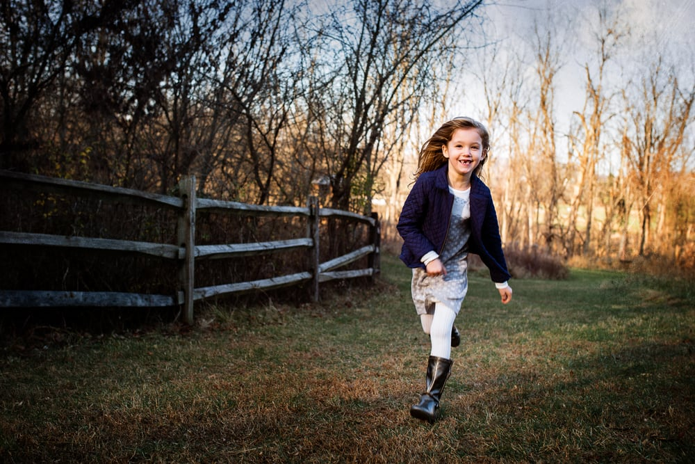 Six year old girl running in motion portrait.