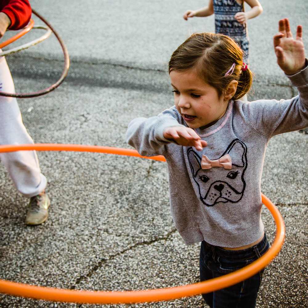 Candid photo of children playing with hula hoops