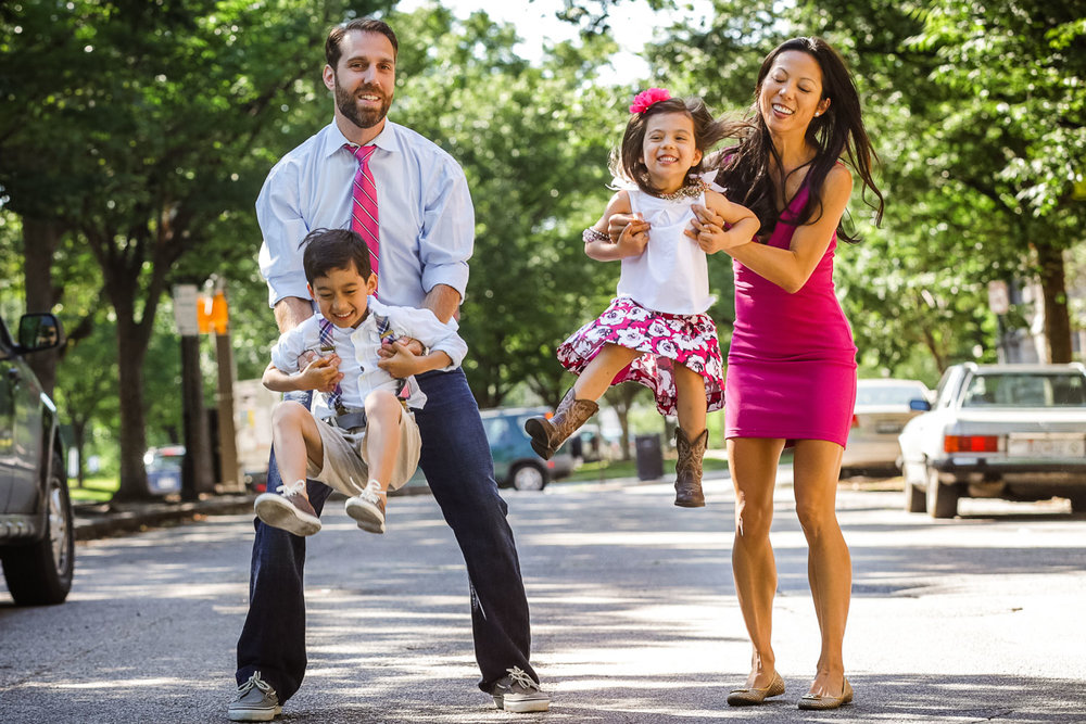 family of five plays together in streets of Baltimore City.