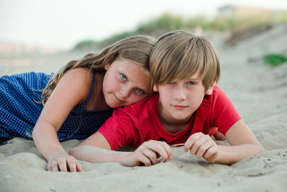 brother and sister beach portrait in ocean city, maryland.