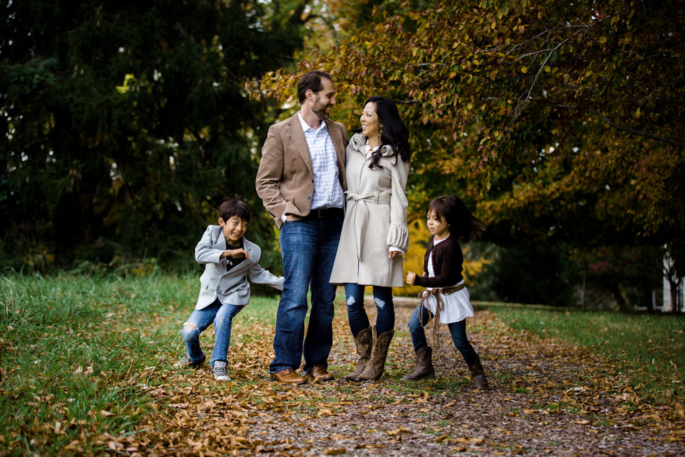 mom, dad, son and daughter portrait in fall foliage