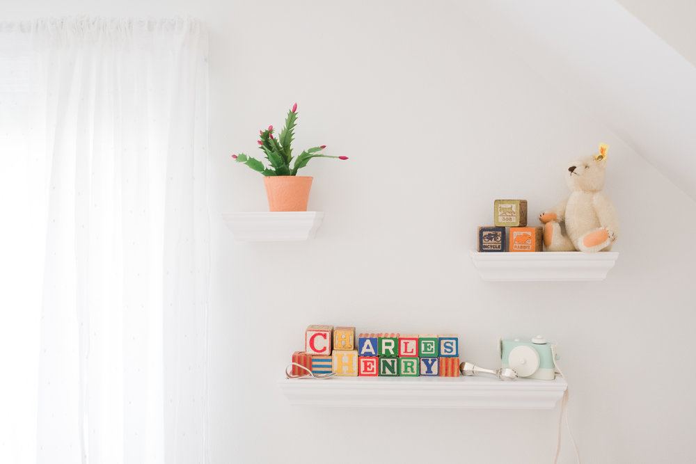 Cute wall display in baby boy nursery