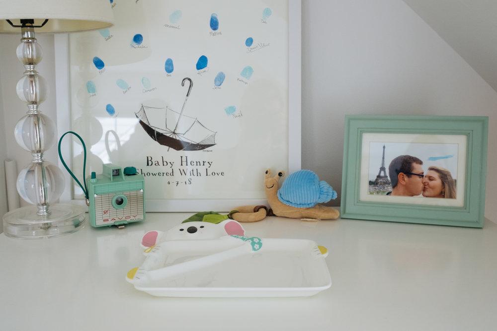 dresser display of special items and art in newborn nursery