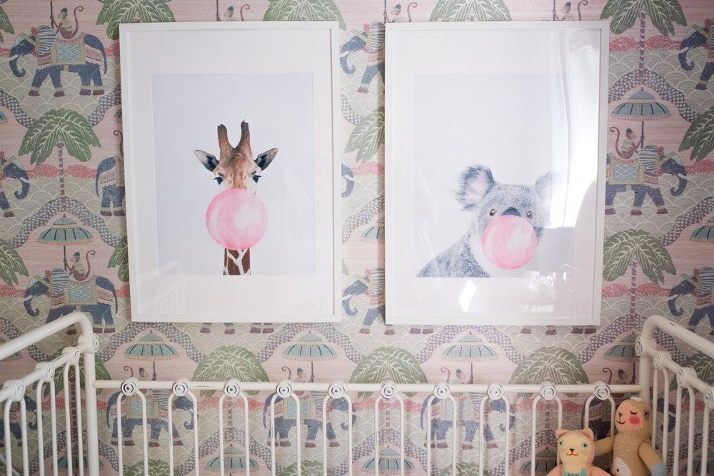artwork of animals on elephant wallpaper in newborn nursery
