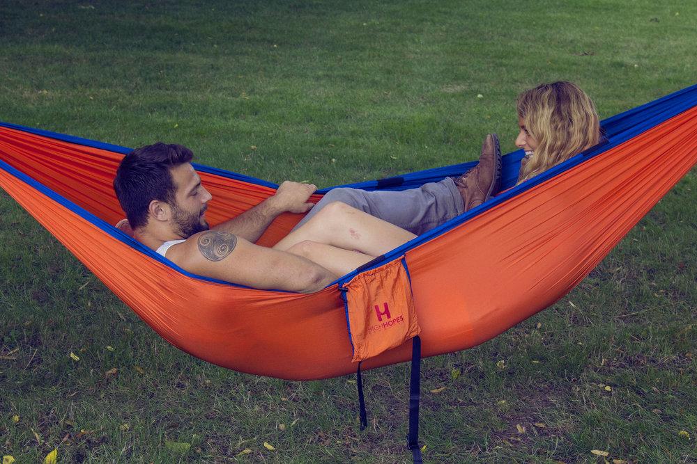 Two happy customers enjoying their hammock.