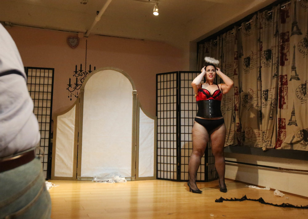 "Amy Brooks (right) performs an original Burlesque routine to Beyonce's song, ""Halo"" while an instructor watches during the final ""Burlesque Your Way"" class before the student showcase in November on Oct. 6, 2016, in Allston, Mass. ""I was always the really big girl, but I was a decent dancer,"" Brooks said, describing her experience as a middle school and high school cheerleader. ""I had to sew two skirts together in order to fit into it because they were so, so tiny."""