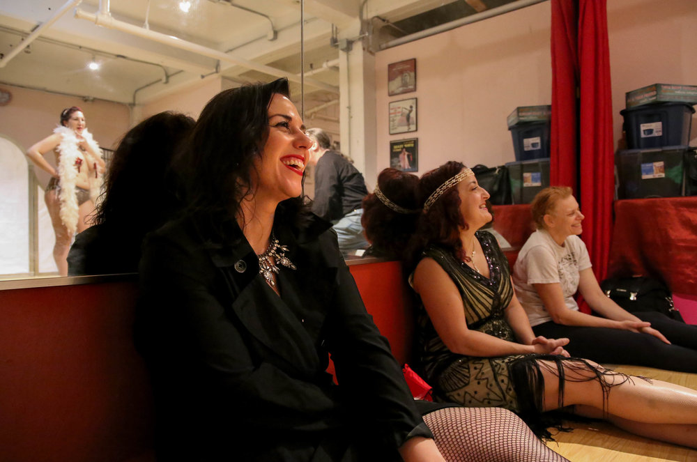 "Amy Brooks (second from left) listens to the Stacey Rizoli's (left) feedback from instructors during the final ""Burlesque Your Way"" class on Oct. 6, 2016 in Allston, Mass. ""I liked that it celebrated women and who we are right now, not who we're trying to be,"" Brooks said describing the class."