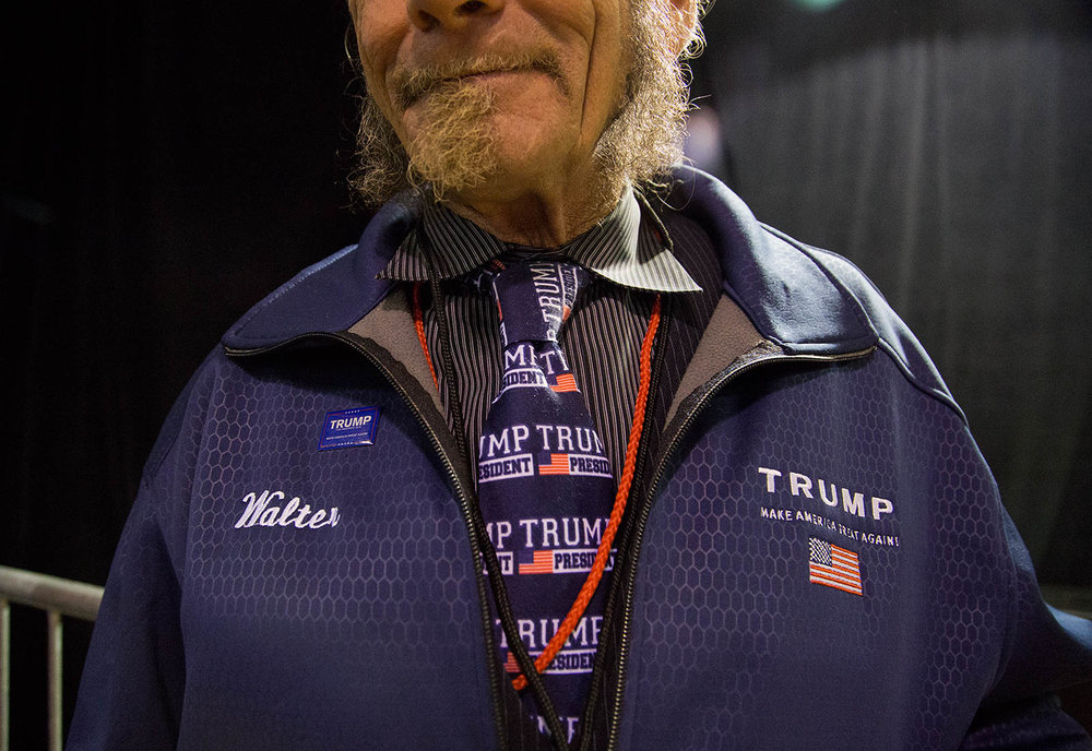 "Walter Collings, 65, of Wilmington, poses for a portrait during the ""Donald J. Trump for President Rally"" on Oct. 28, 2016 in Manchester, N.H. He has been a volunteer for Trump's campaign since last September, and this rally marked his 33rd event, he said."
