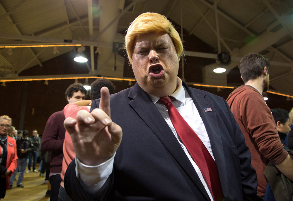 "Eric Jackman, 30, of Jaffrey, N.H. impersonates Donald Trump before the start of the ""Donald J. Trump for President Rally."""