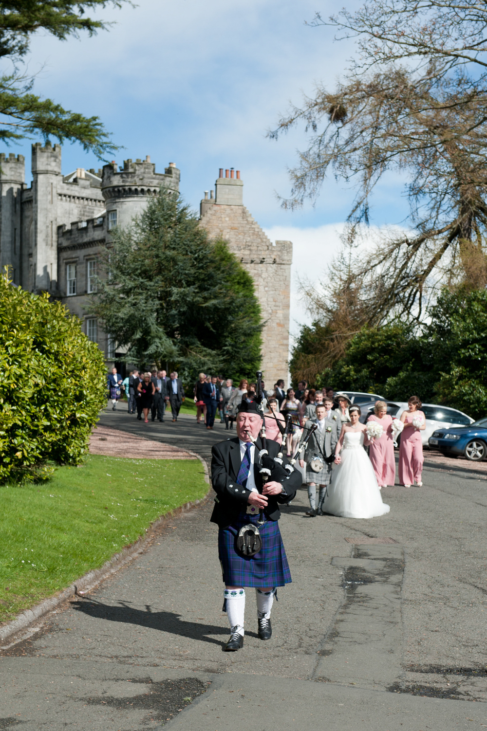 airth-castle-wedding-piper-kilt-scotland.jpg