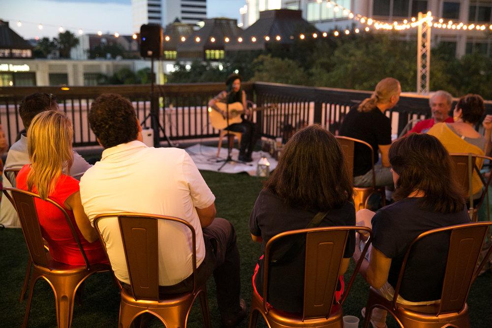 Attendees enjoy live acoustics by Geri X