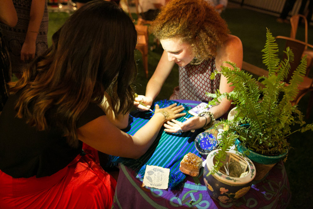 Henna artist Wynn Grissom with local nonprofit leader Kate Berlin of Purple Dot Yoga Project.