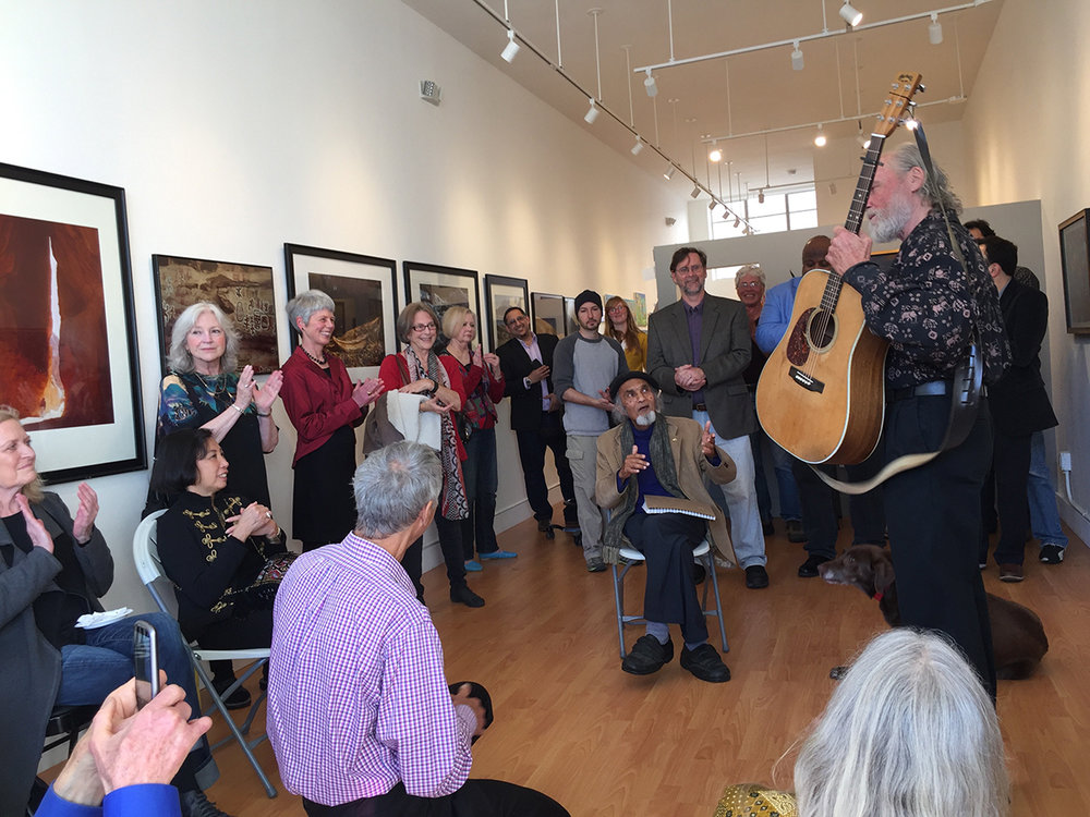 Peter leads us in a song by Woody Guthrie:  This land is your land, This land is my land...