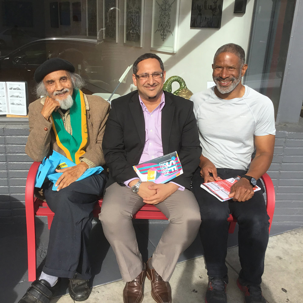 Mamade  and his pals Ibrahim and Munir Jiwa outside the gallery in November 2016.