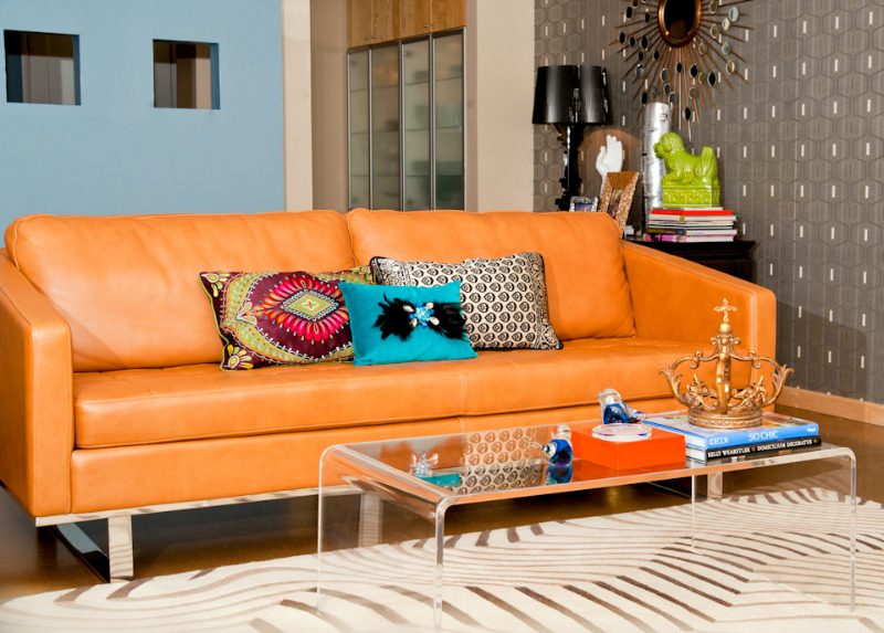 orange-leather-sofa-acrylic-coffee-table.jpg