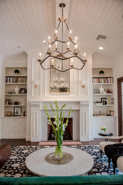 5+GreatRoom+Millwork+Chandelier+Fireplace+PlankedCeiling+GreenSofa.jpg