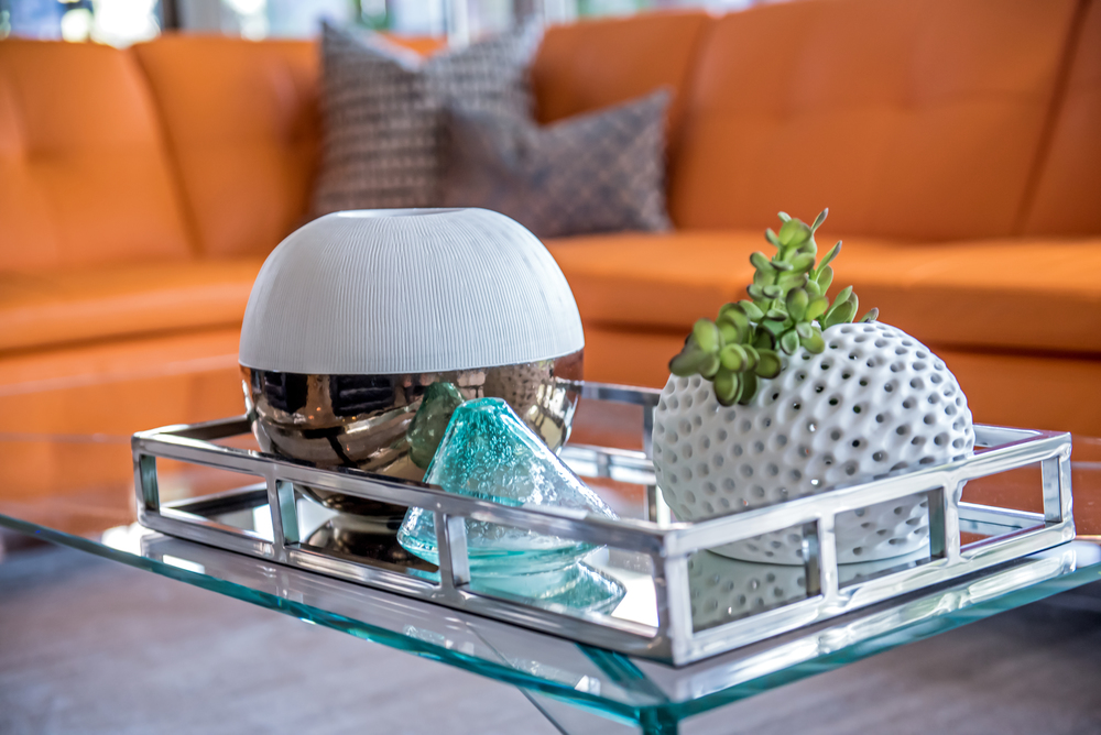 Arizona is known for its bright sunshine and hot weather, so what better way to show that in an interior with all the yellows! We are cactus central when it comes to landscapes so, mixing that feature with the colors is a perfect representation of a 'sizzeling' design.