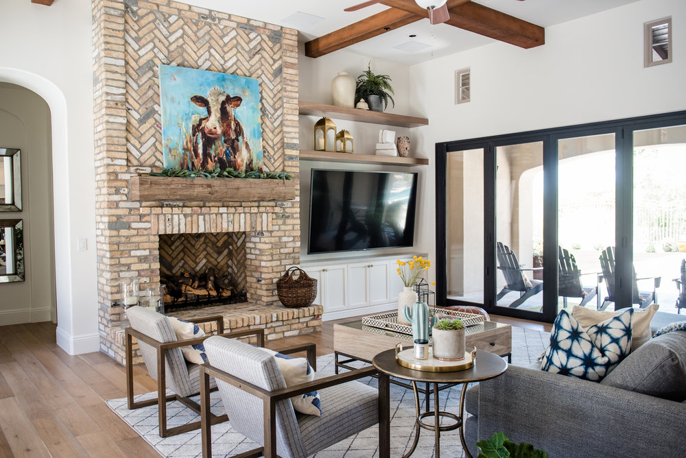 32+fireplace+brick+woodenchairs+art+brass+accessories+builtins+familyroom+rug.jpg