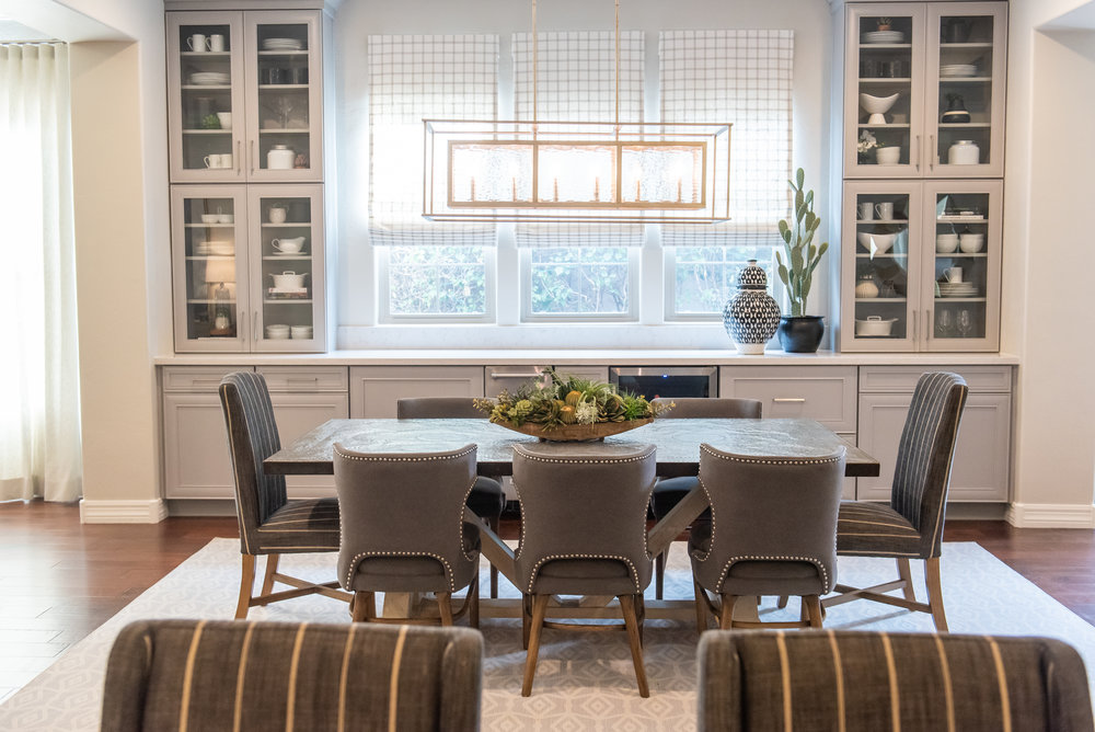 Diningroom + Built-in cabinets +chandelier +roman-shades +nailhead +dining-chairs.jpg