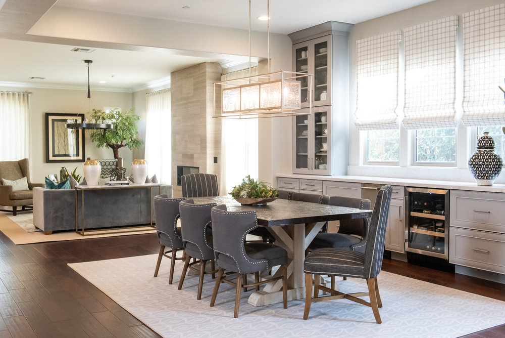 Diningroom +chandelier +vase +romanshades +stripped dining chairs.jpg