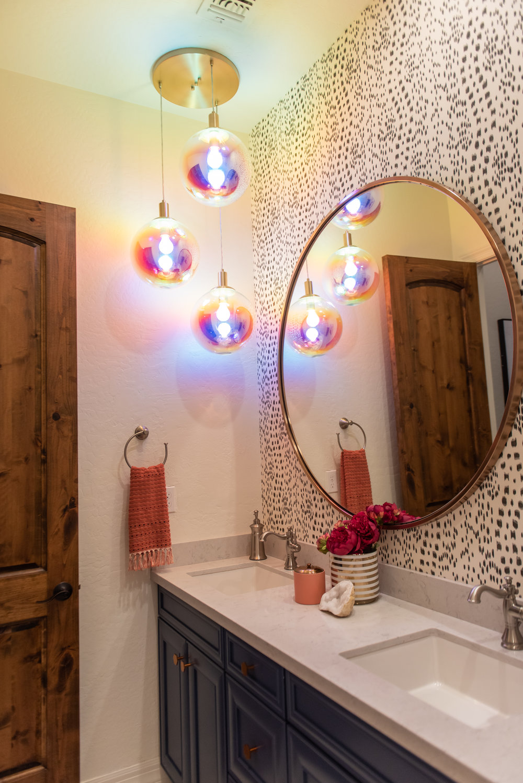 girls bathroom +round +mirror +lighting +wallpaper.jpg