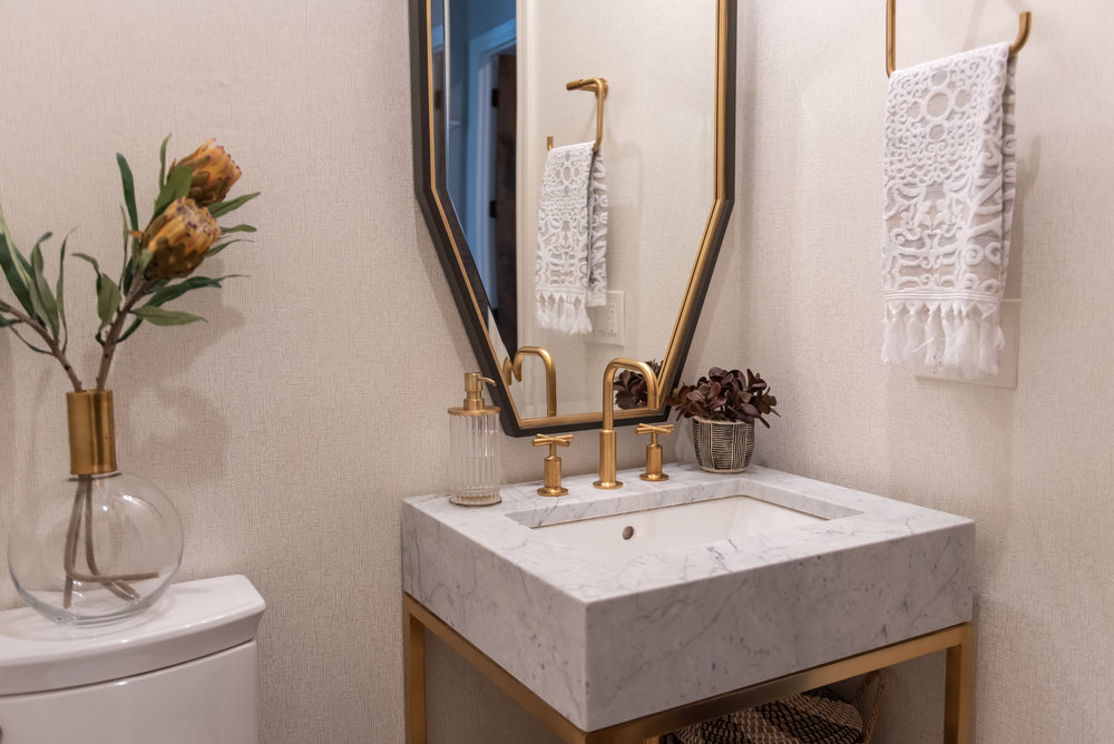powder bathroom +octagon +mirror +brass +marble +countertops.jpg