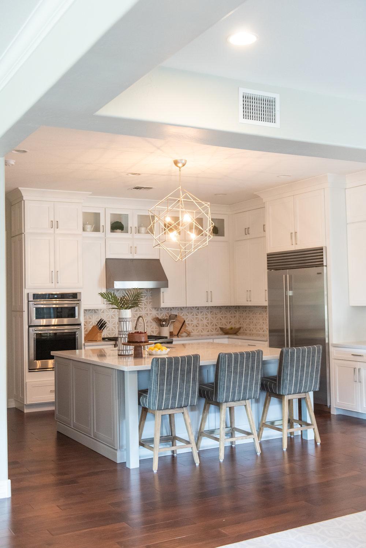 Kitchen +geometric +lighting +blacksplash +hood +barstools +silestone +woodfloors.jpg