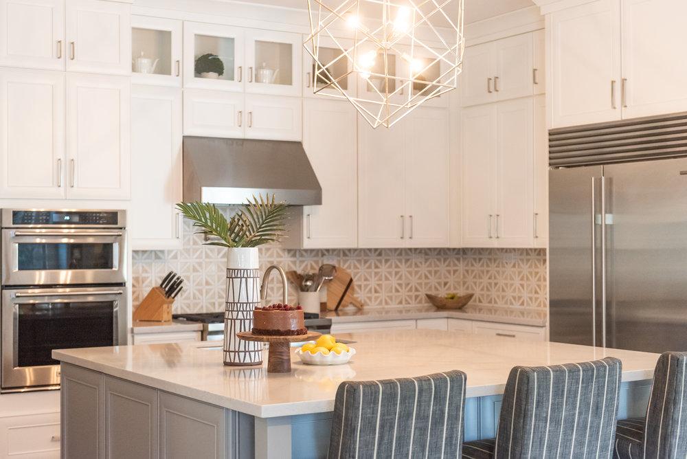 Kitchen +geometric +lighting +blacksplash +hood +barstools +silestone.jpg