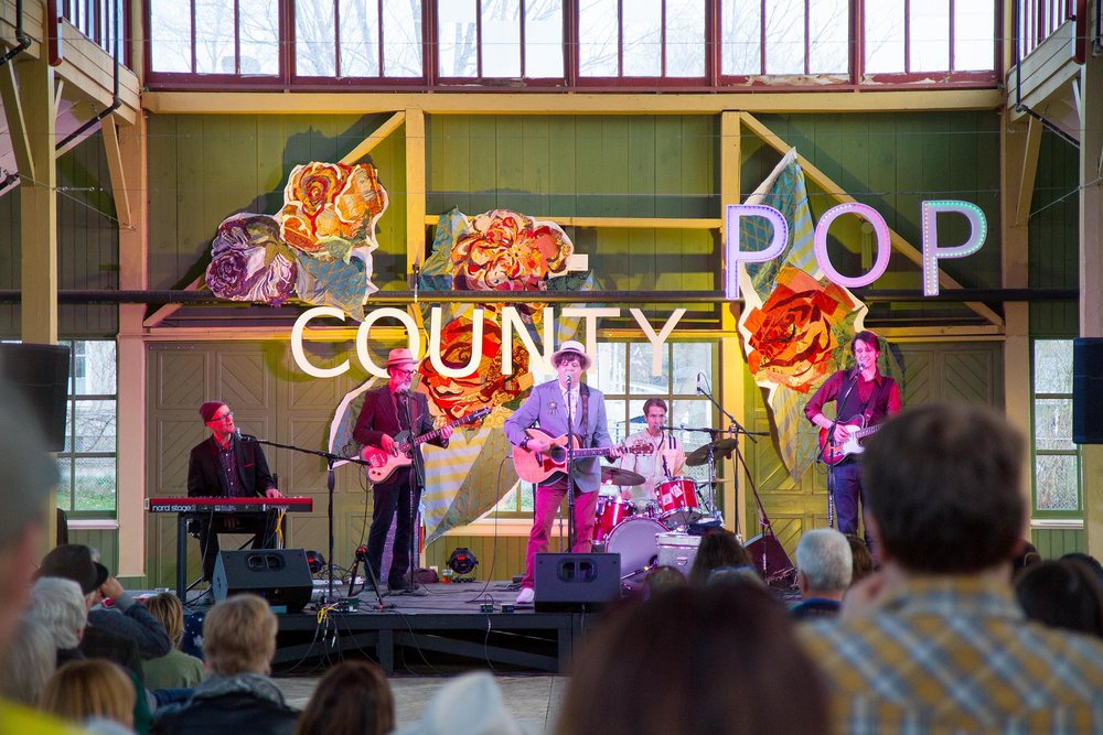 Suendrini's art makes the County Pop 2016 stage really pop!