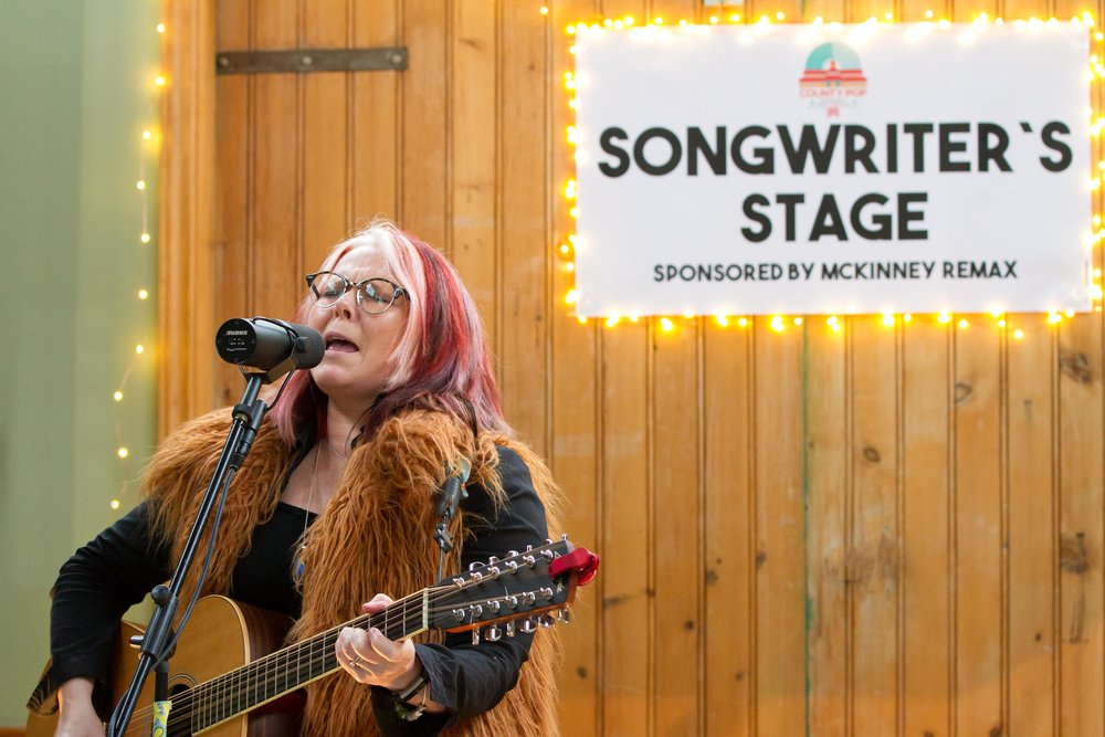 Astrid Young plays the Songwriter's Stage (photo by Bob Ullrich)