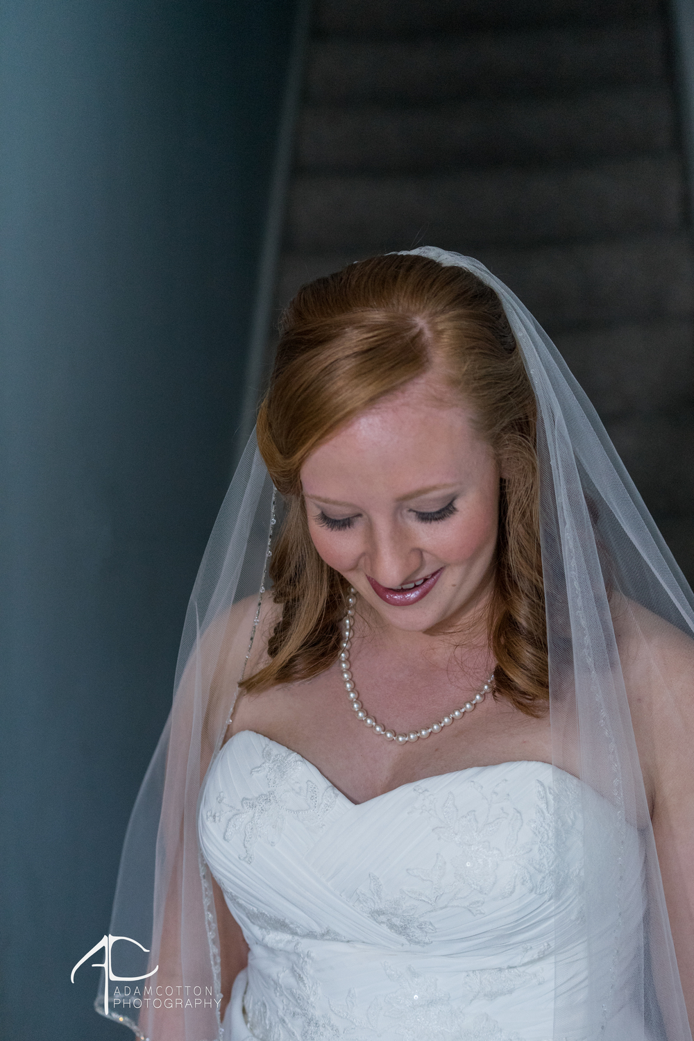 beautiful image of bride coming down stairs by wedding photographer adam cotton