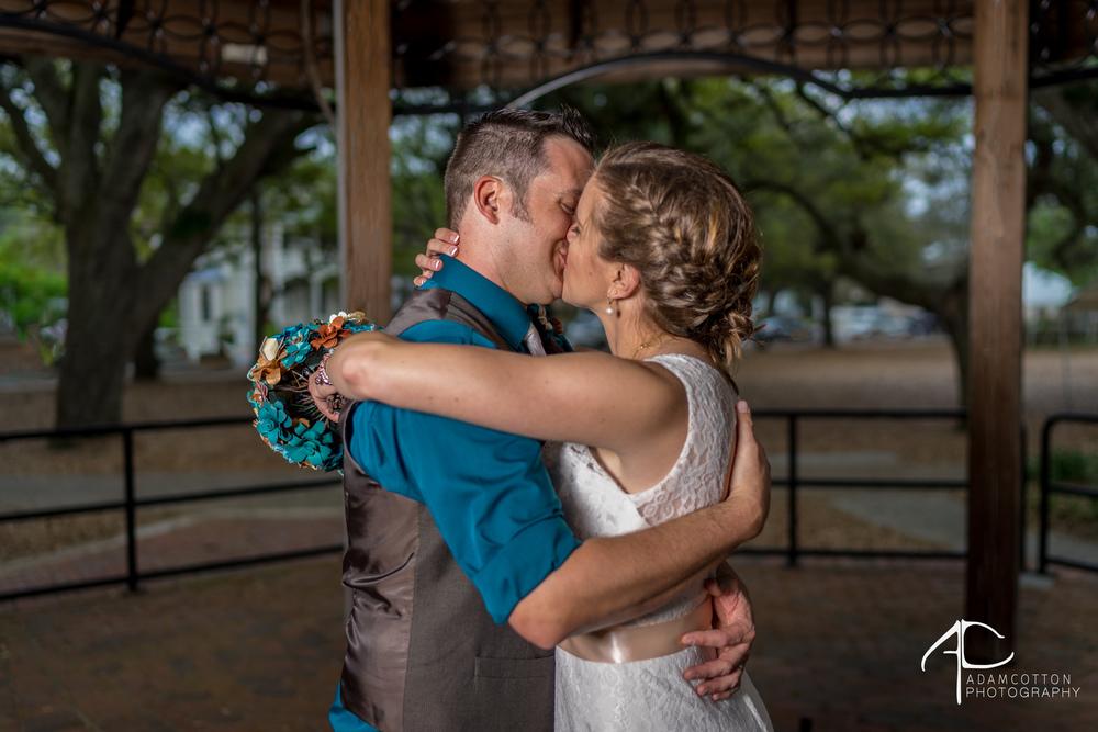 bride_and_groom_kissing_downtown.jpg