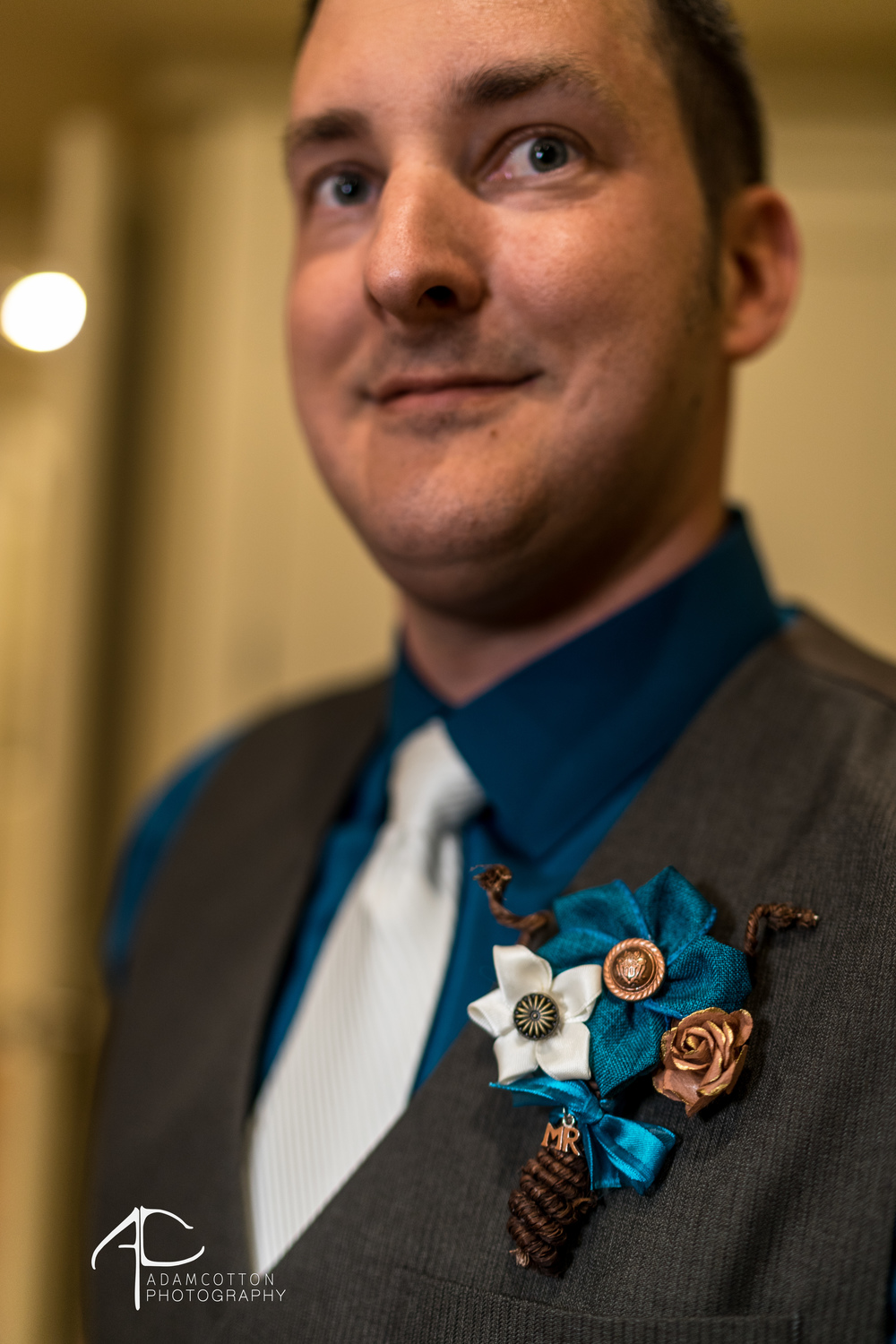 close up image grooms boutonniere white tie tux wedding