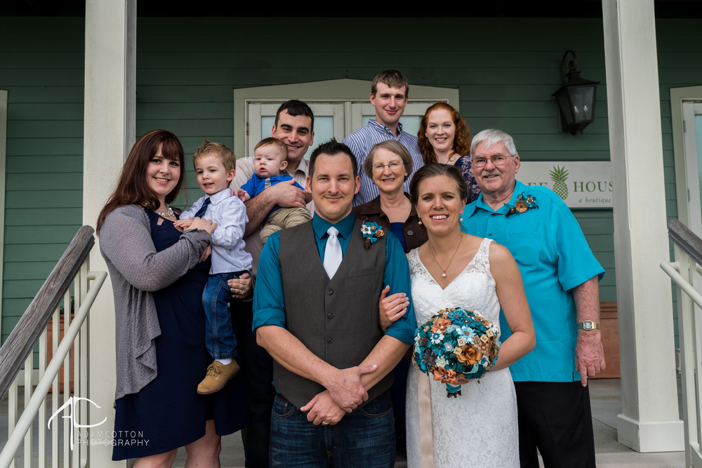 fimage of groom's family formal portrait wedding venue Lee House Pensacola with Bride photographer adam cotton