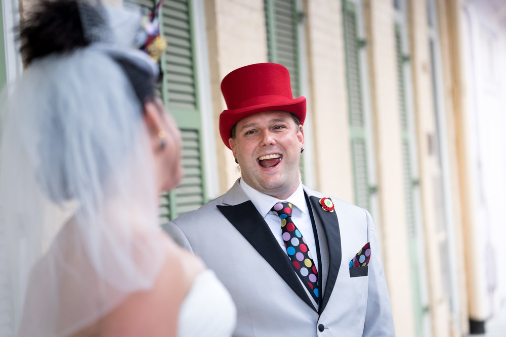 image of groom smiling first look with bride from pensacola wedding photographer adam cotton