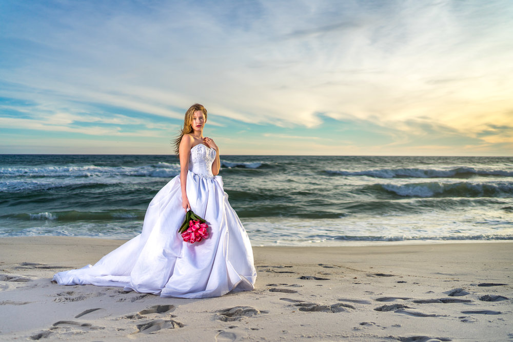image of bride with wedding dress and bouquet by photographer adam cotton