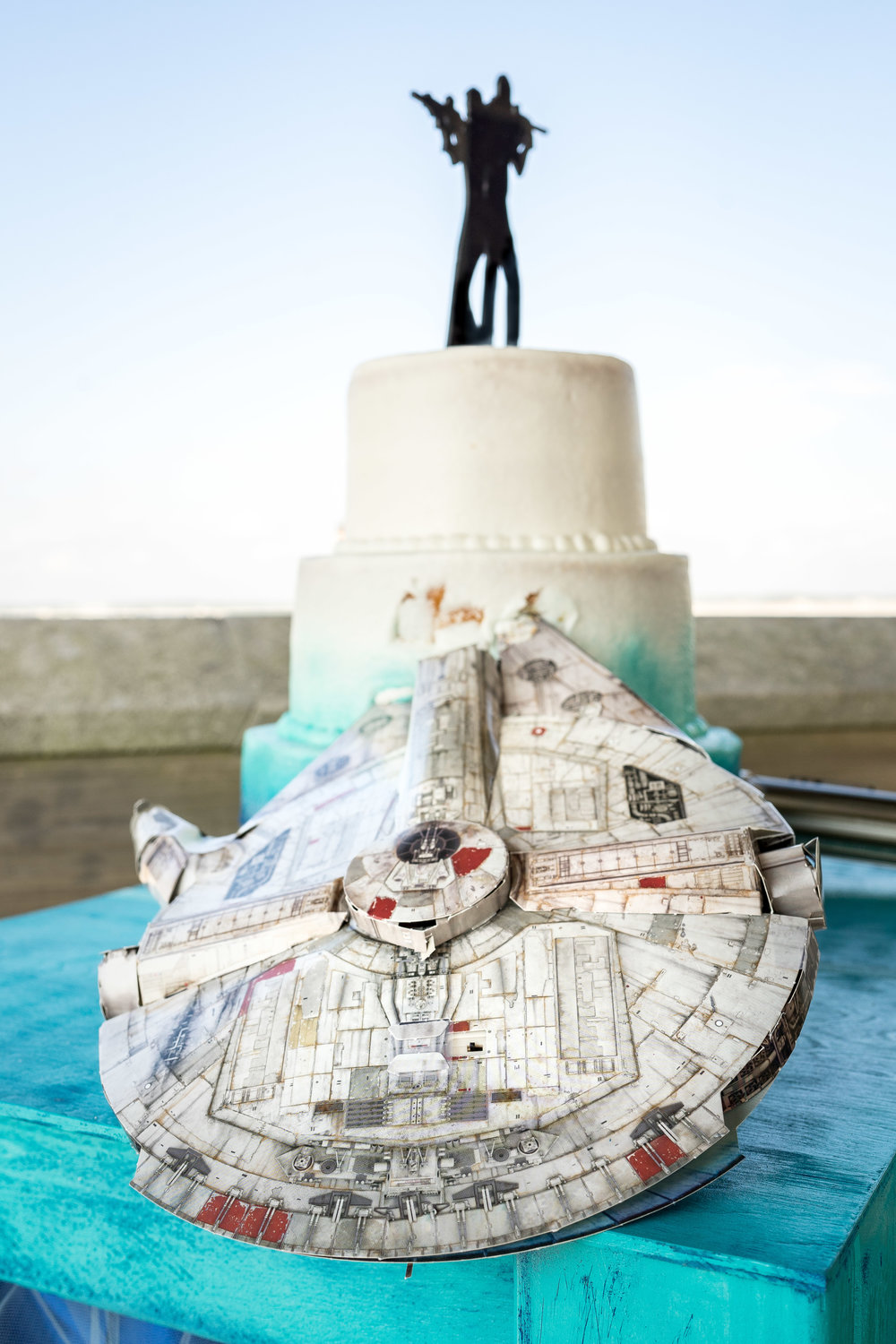 image of millennium falcon crashed into wedding cake pensacola wedding