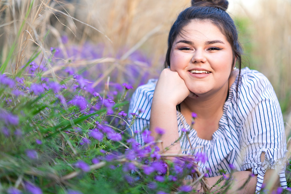 senior portrait from baltimore photographer with beautiful purple flowers